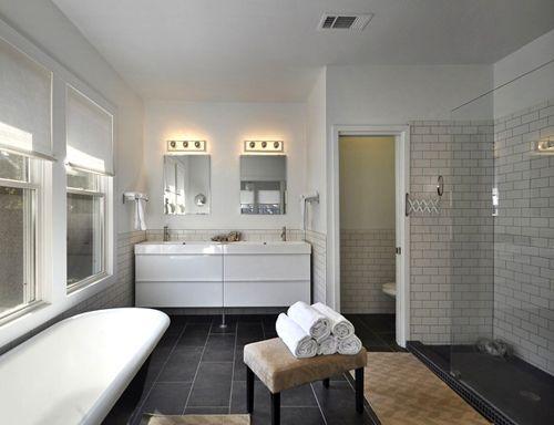 white bathroom with dark floors