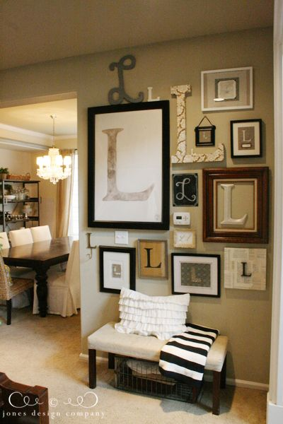 wall of l's - use your initial and hang a grouping of them for a personalized gallery wall {plus, this disguises the thermostat & light switch!} - like my G wall