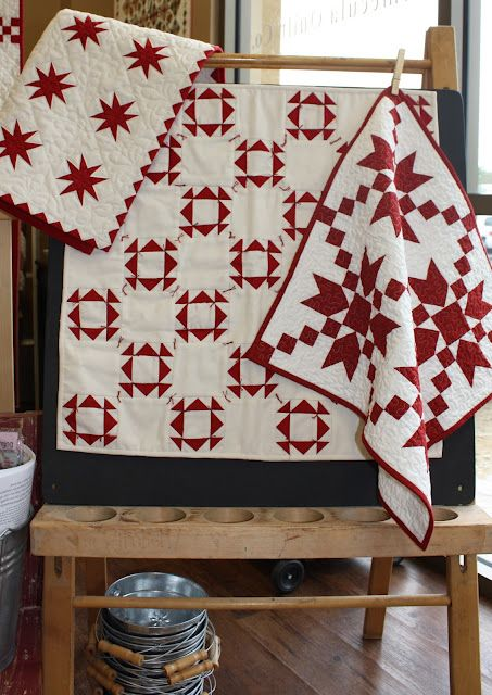 A Collection of Small Red and White Quilts.