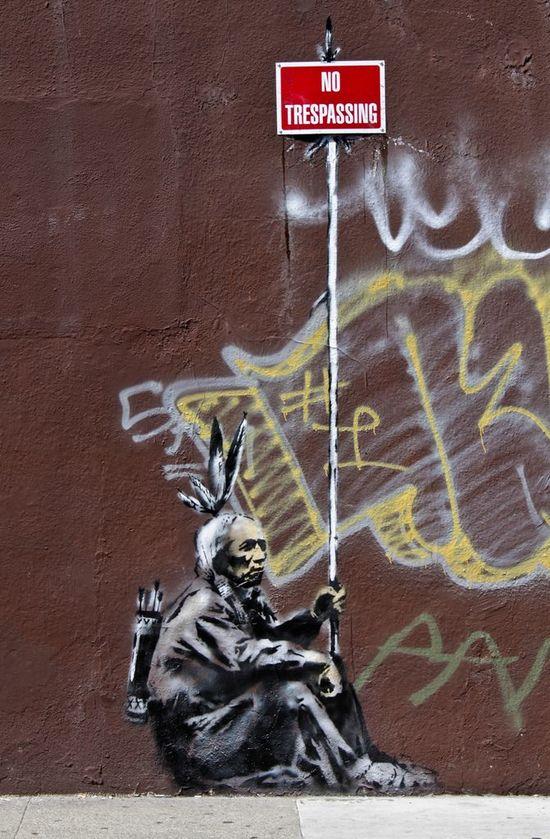 banksy street art indian no trespassing