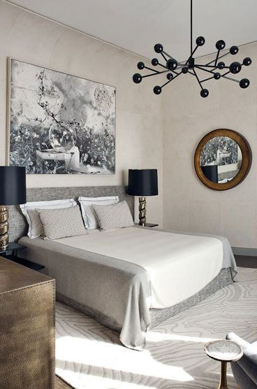 Soft hues with black accents in this glamorous bedroom