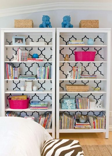 love the wallpaper used as a backdrop on these shelves