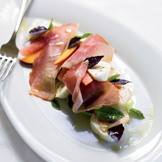 Melon-and-Peach Salad with Prosciutto and Mozzarella // More Quick Appetizers: www.foodandwine.c... #foodandwine