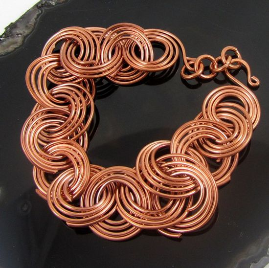 I would curl the end inward in a small spiral to keep them from catching on things.    Spiraled Copper Links Bracelet by TwiningVineDesigns