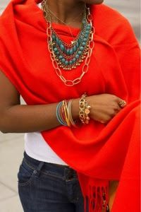 Love the layers of jewelry against the scarf