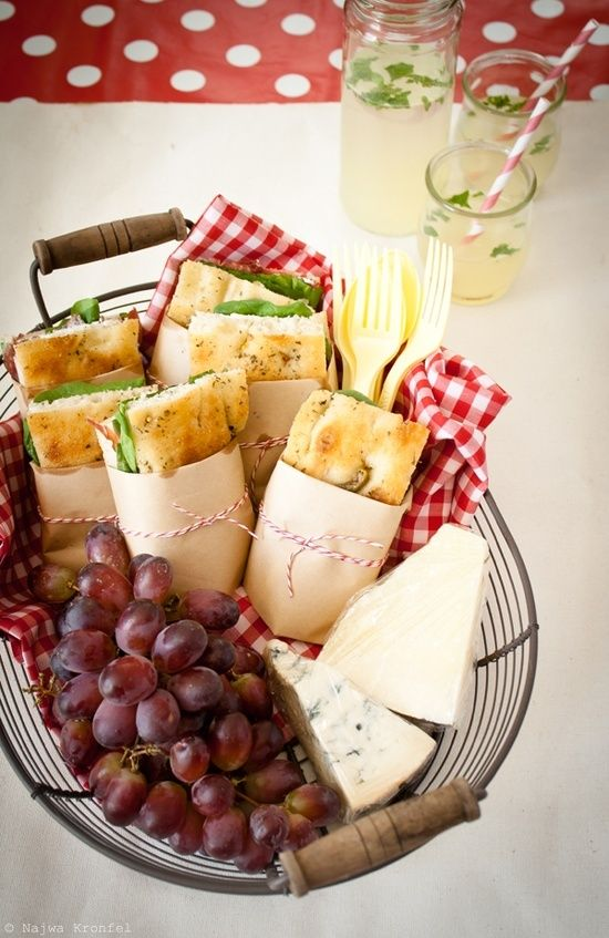 Sandwiches cheese grapes, lemonade, picnic food.
