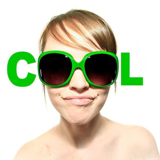 "Fun portrait of girl wearing ""cool"" sunglasses."