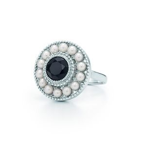 Ziegfeld Collection pearl ring in sterling silver and black onyx.  Gleaming pearls in a milgrain frame recall chic looks from the Roaring Twenties. Ring in sterling silver with a round black onyx and freshwater cultured pearls. Pearls, 3.3 mm. $475.00