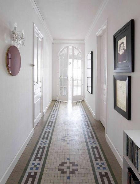 Narrow Entry Hall: Tile Floor Creates a Welcoming Runner +Arched French Doors +Light +Sparing Decor Keeps An Airy Feel To The Narrow Space