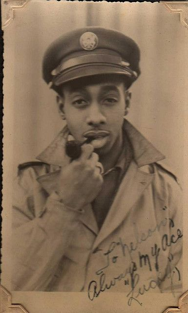 """Black soldier stationed in France during World War II. Inscription reads: To Nelson - Always my ace, """"Lucky"""""""