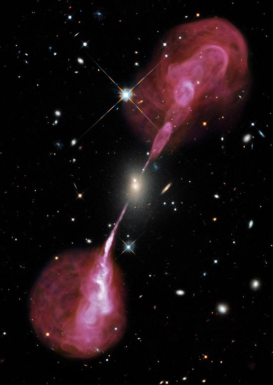 Jets of relativistic plasma created by the Supermassive Black Hole at the center of 3C 348; a galaxy in the Hercules Cluster 1000 times more massive than the Milky Way.  The jets are focused beams of particles accelerated to more than half of light speed by the magnetic fields around the Black Hole.  The jets extend more than a million light years into intergalactic space.  This image is a combination of visible light observations by the Hubble Space Telescope and radio observations by the VLA R