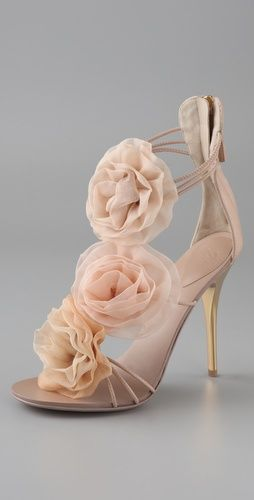 These are a very pretty pair of shoes. Delicate to almost fragile in there make up. Beautiful heel giving way to minimal straps hidden behind gorgeous flowers. Where are these from ? I want them in my Shop. Comment is by Peter Greenaway from The Wedding Boutique specialist bridal shoes. www.bridalshoesuk...