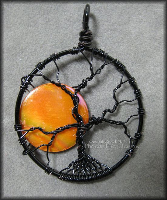 life pendant with orange pearl coin bead in black wire