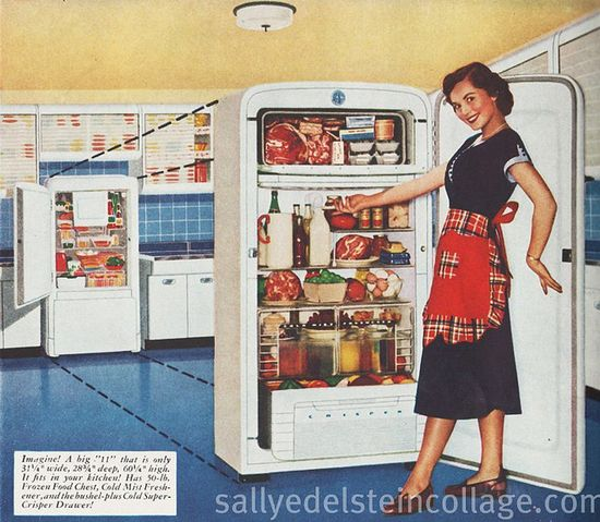A smiling homemaker proudly posing with her new Kelvinator. #homemaker #housewife #woman #1950s #ad #vintage #fifties #food #retro #kitchen #fridge