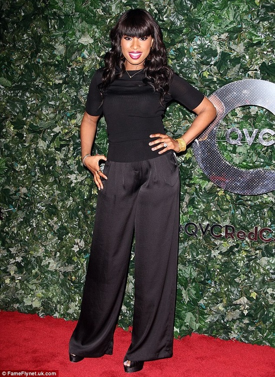 Elegant: Newcomer Jennifer Hudson, who has shed over 80 pounds since starting her career, showed off her slim physique in a black shirt and pants from her QVC line