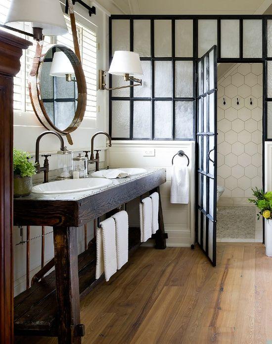 White tile, rustic wood, bronze fixtures, earthy bathroom