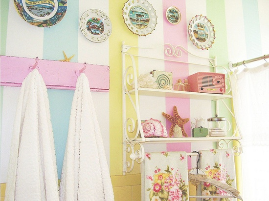 Our salt water taffy, vintage vacation bathroom. When your apt. gives you lemons..I mean lemon colored tile...you make lemonade! ;) #jenny holiday #beach #vintage #seashore #summer #collectibles #souvenir# plates #stripes #striped #pink #pastel #bath #retro