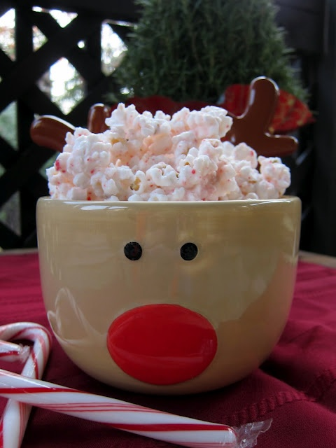 2 bags microwave popcorn, popped (18-20 cups)  1 6oz box candy canes, crushed  1 package White Chocolate  1 tsp peppermint extract or a few drops of peppermint oil    Place popcorn in a very large bowl - the biggest one you have. Pour crushed candy canes on top of the popcorn. (I crush my candy canes in the food processor - it is quick and it pulverizes the candy canes!)