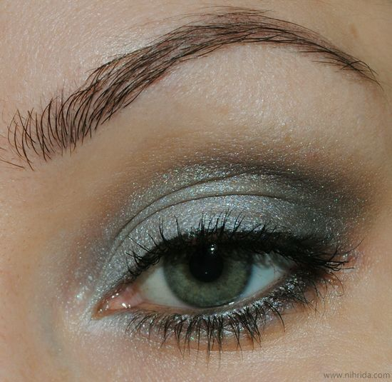 Eye makeup in greyed jade