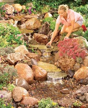 Step by Step - Build a Backyard Waterfall and Stream-- use the same general idea for stone layout for our dry creekbed in the back yard, then wait for the rain and a beautiful stream to form.