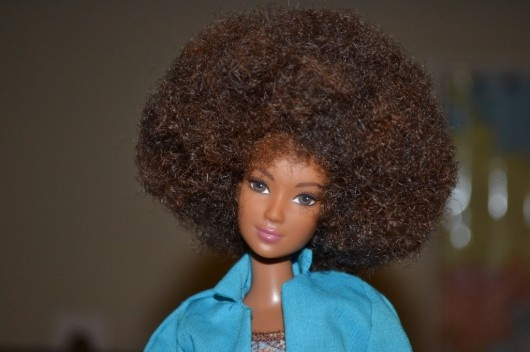 The new Black Barbie rocking her natural hair since 2006.