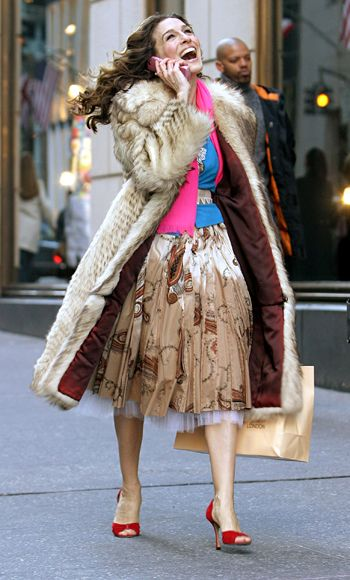 """This is Carrie shaking off whatever she left in Paris,"" said Rubenstein of the colorful vintage outfit she topped with her signature coat after Big rescued her in Season 6. ""She's back in N.Y.C. which is all about a series of clashing: mixing high and low, uptown and downtown. This is when Carrie's real style takes over again."""