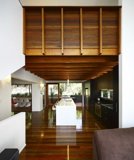 Timber wrapping up from kitchen ceiling to balustrade