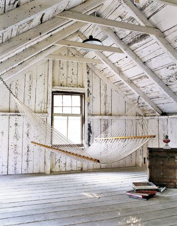Cottage Decor: Distressed Wood Walls in Attic with Hammock
