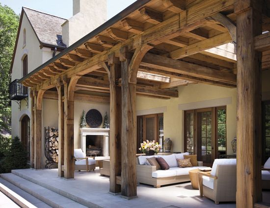 wood pergola, wide steps, outdoor fireplace.
