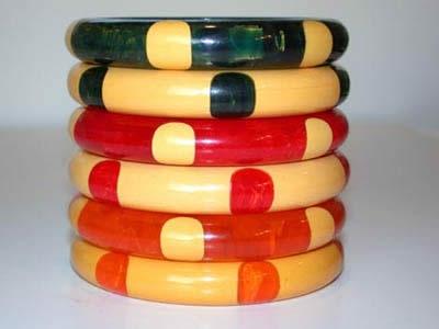 Bakelite 6-dot bangles, matching pairs. 'Blue Moon' Set; Red Marbled Set; Orange Marbled Set