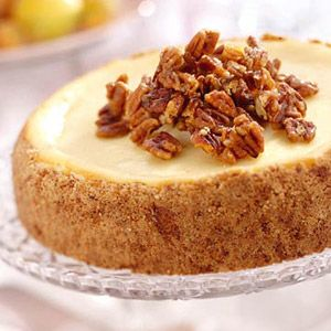 Shortbread cookies and candied pecans make the crust for this creamy cheesecake. Top with additional candied pecans before serving this delicious dessert.