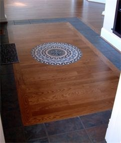 Entry Floor : Tile Carpet w/ Wood Inlay & Tile Medallion at Forest Glen