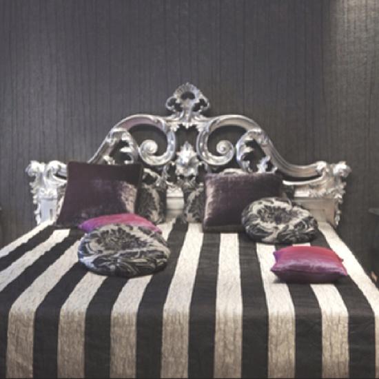 Dark striped bedroom