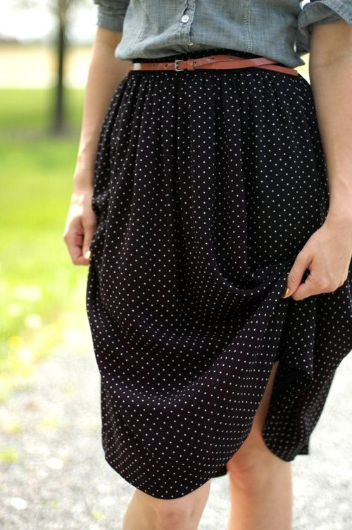 black polka dot skirt with a chambray shirt and a brown belt.