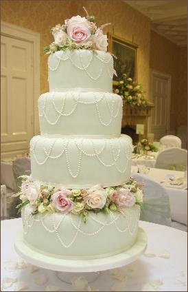 Green Draping Pearl and Roses Wedding Cake