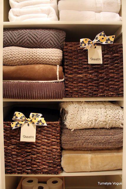 Organized Linen Closet, baskets for sheets.
