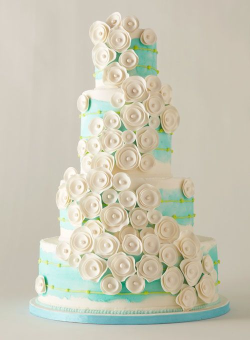 With pearl-studded flowers #weddings #weddingcake