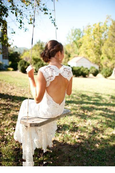 I love open back lace wedding dresses, so pretty!