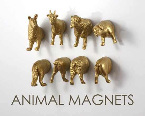 #DIY - buy a set of little plastic animals at a craft store, cut them in half, spray paint them, glue a magnet on each half, and voila! Funny little magnets for your fridge (or super fun office space)