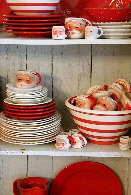 What a fabulously cool collection of red and white vintage dishes and Santa Claus mugs. #vintage #kitchen #dishes #kitsch #kitschy #Santa #mugs #Christmas #red #white