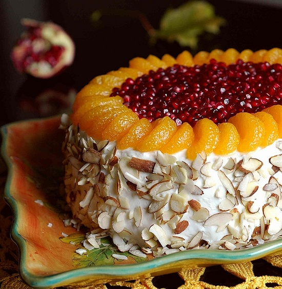 Immensely beautiful Pumpkin Citrus Cake with Pomegranate Seeds and Almonds. #cake #fruit #decorated #fancy #food #baking #dessert