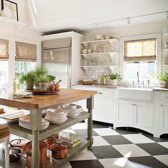Bold patterned tile makes a statement in this light and airy kitchen. See more ideas for kitchen floors: www.bhg.com/...