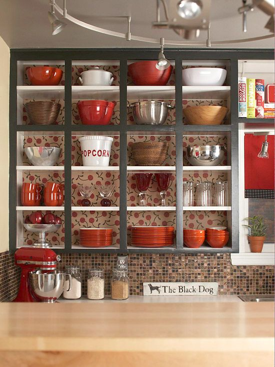 Keep your shelves open to create a fun way to keep your kitchen organized! More kitchen cabinet ideas: www.bhg.com/...