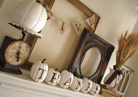 Fall mantle- I like the black and white, would go well with modern decor.