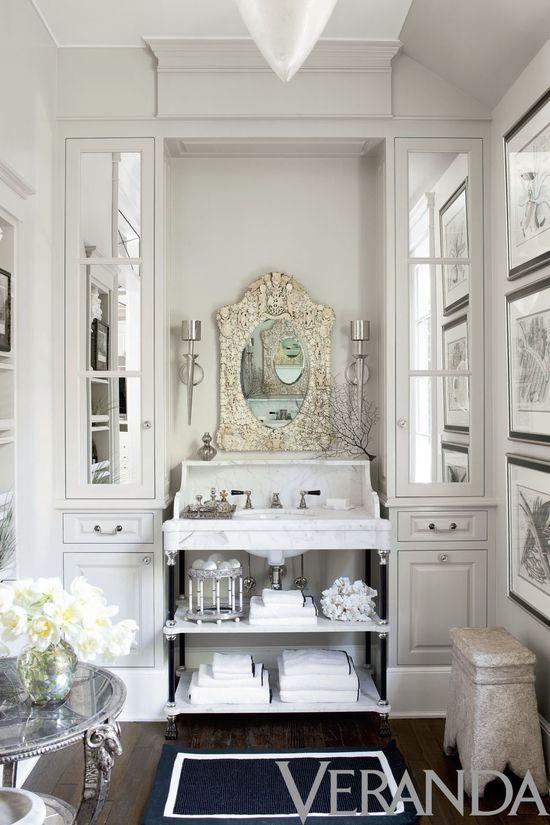 House of Windsor bathroom - small, lots of storage.  Love the mirrored door.