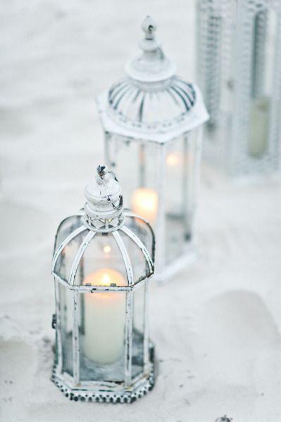 White-washed lanterns. The perfect beach side wedding decor;) Photo by Style Art Life