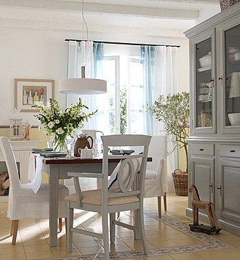 love the two chair styles, gray table and hutch, soft white walls...awesome light