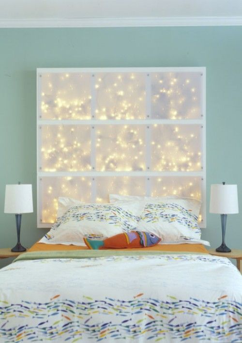 Add some mood lighting with this fun DIY headboard project constructed by building a simple wood frame out of 2x4s, adding crossbeams, then drilling small holes in the bottom of each section to pull strands of mini LED lights through. You'll need multiple sets of mini lights for this project. You'll also need to be able to connect all the cords together. Polycarbonate sheets (cut to fit) make ideal translucent panels that can easily be affixed to the base of the headboard with screws.