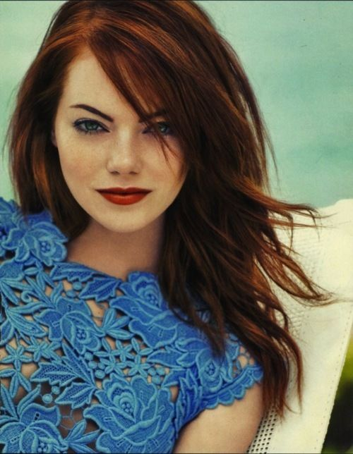 emma stone. I love the colors here - the dress, brows, hair, background all come together so nicely.