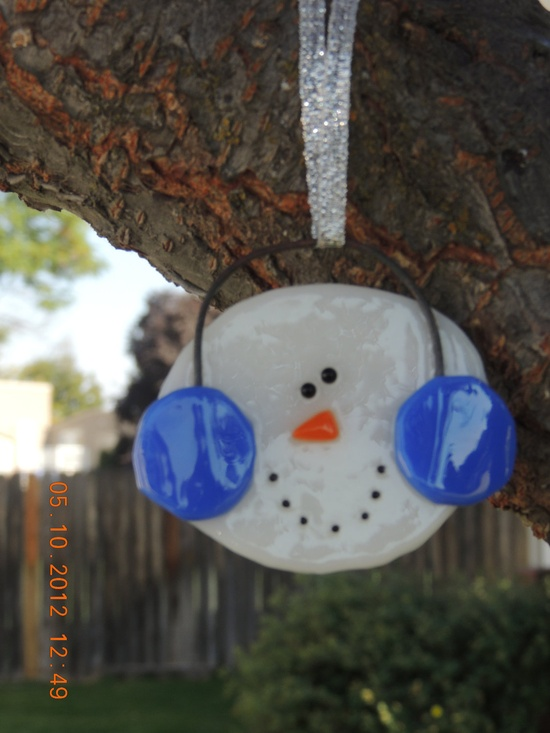 Fused glass snowman ornament with cobalt blue earmuffs. $12.00, via Etsy.